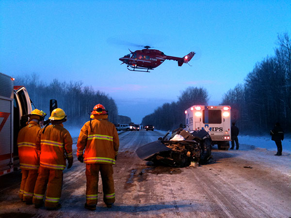 Car accident, ambulance, firefighters, helicopter